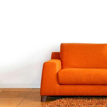 Comfort orange textile sofa in living room  photo