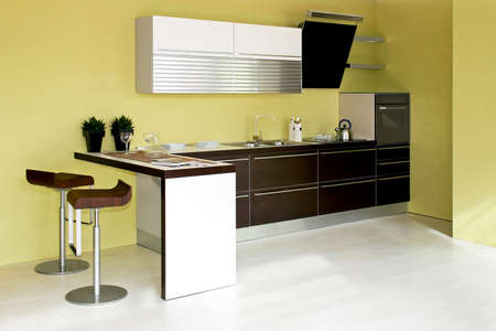 Contemporary brown kitchen furniture and green walls Stock Photo - 3082368