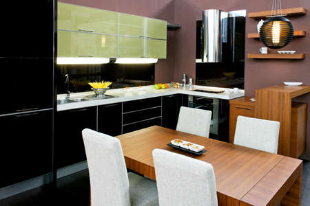 Contemporary kitchen with brown dinning table and chairs photo