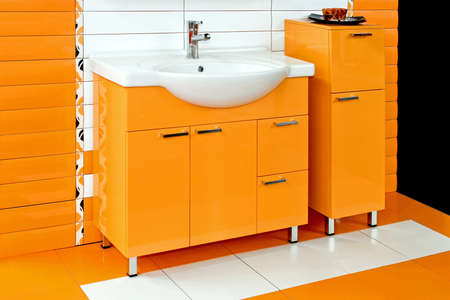 basin: White basin with orange ceramics in bathroom