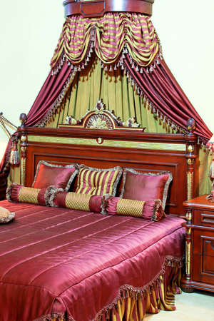 canopy: Big royal engraved bed with luxury baldachin Stock Photo