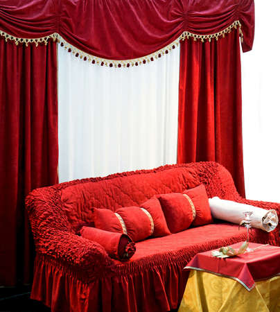 Old style interior with big red sofa and curtains  Stock Photo - 3094243