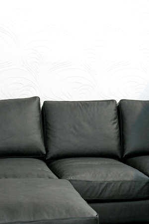 Soft black leather sofa over white wallpaper Stock Photo - 3094230