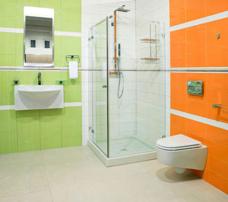 Contemporary bathroom with green and orange ceramics Stock Photo