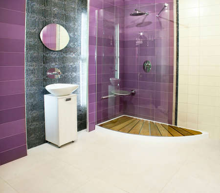 lavabo: Big bathroom with purple ceramics and glass shower Stock Photo