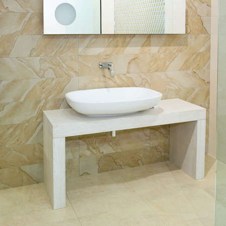 Wide oval basin and marble ceramics with mirror photo