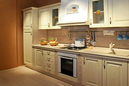 country home: Vintage style kitchen interior in beige color