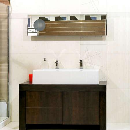 Big double faucet sink over wooden locker Stock Photo - 3133554