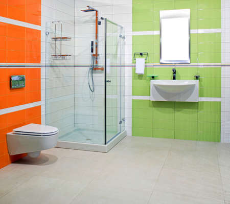 lavabo: Contemporary bathroom with green and orange ceramics Stock Photo