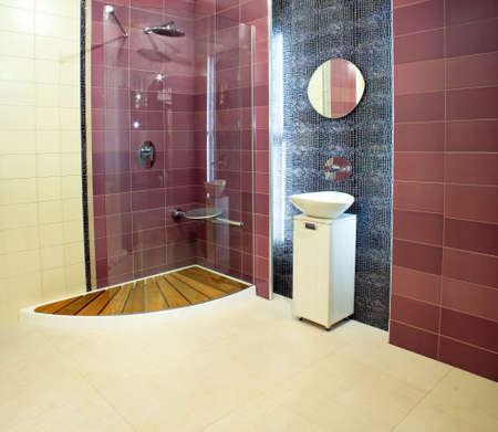 basin: Big bathroom with purple ceramics and glass shower Stock Photo