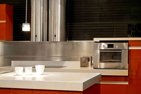 Modern kitchen with metallic oven and ventilation  Stock Photo