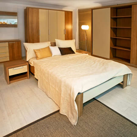 Standard bedroom in apartment with wooden furniture Stock Photo - 3180618