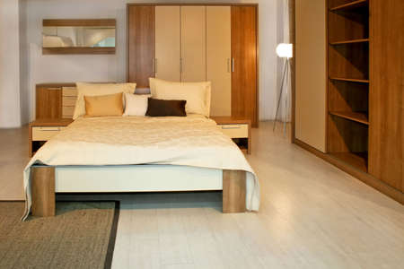 Standard bedroom in apartment with wooden furniture Stock Photo - 3180568