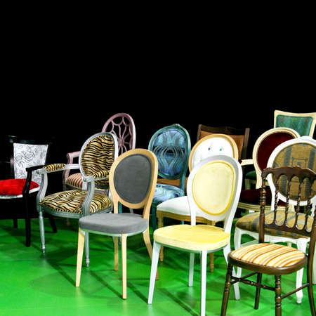 dozen: Dozen various chairs all shapes and colors Stock Photo