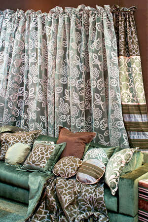 Interior with bunch of pillows and floral curtains