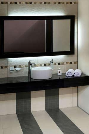 Luxury bathroom with modern basin and big mirror