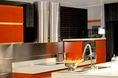 Double metallic ventilation in modern red kitchen Stock Photo - 3206262