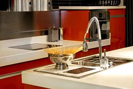 Spaghetti in metal bowl on kitchen counter Stock Photo - 3206264