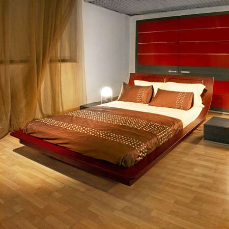 Modern bedroom with big red bed and closet  photo
