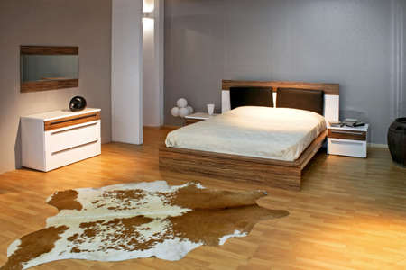 cowhide: Bedroom in gray style with big bed Stock Photo