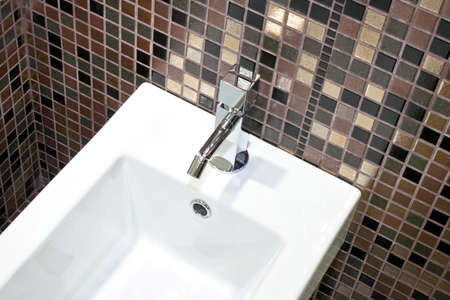 lavabo: Square shape of geometric basin and brown tiles