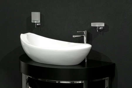 stainless steel sink: Oval shape white basin over black wall