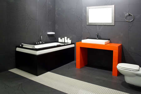 Contemporary black bathroom with orange wash basin