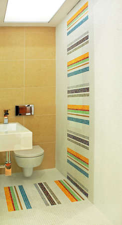 Basin and toilet in colorful small lavatory angle Stock Photo - 3265426
