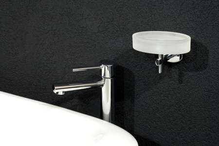 Faucet and white basin over black wall