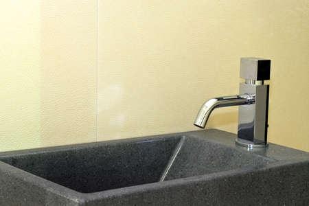 Small grey granite basin and silver faucet Stock Photo - 3265446