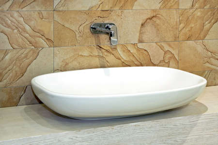 lavabo: White and wide basin and marble wall Stock Photo