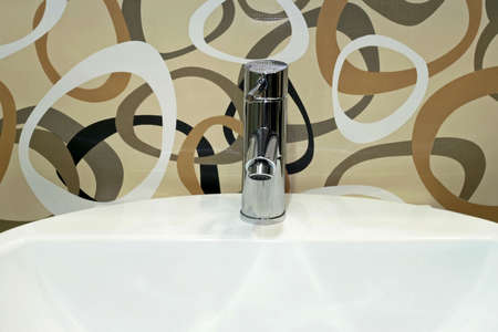 Basin and faucet over modern designed tiles Stock Photo - 3265421
