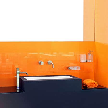 Contemporary bathroom basin with vivid orange wall Stock Photo - 3265418