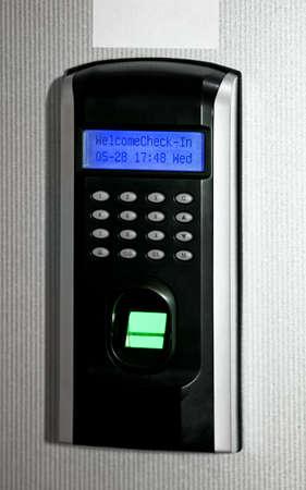 teclado num�rico: Finger esc�ner de impresi�n para fines personales de identificaci�n biom�trica  Foto de archivo