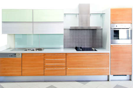counters: Oak wood kitchen with blue glass details Stock Photo