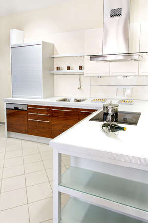 kitchen counter: Silver kitchen counter with wooden front panels Stock Photo