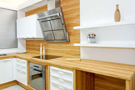 Complete wooden kitchen horizontal in new apartment photo