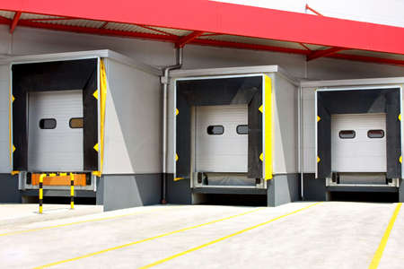 commercial docks: Loading warehouse deck with big cargo doors  Stock Photo