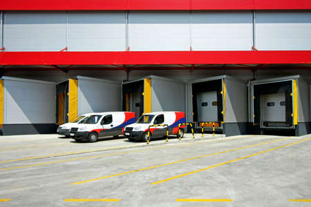 Loading delivery vans in front of cargo doors  photo