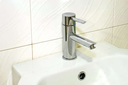 Water faucet in silver and white basin Stock Photo - 3339383