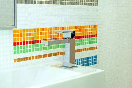 Basin and faucet in bathroom with colourful tiles Stock Photo - 3346811