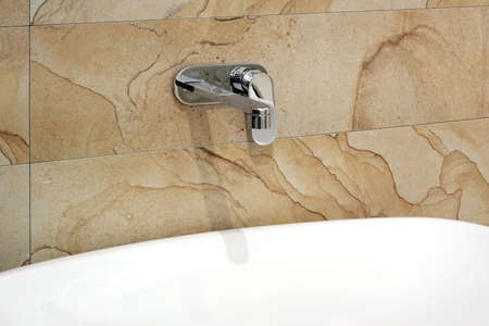 White basin and silver faucet over marble wall Stock Photo - 3346845