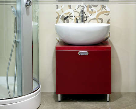 lavabo: Modern round white basin over red cabinet Stock Photo