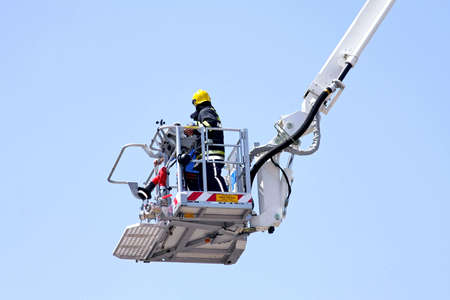 fire fighter: Fire fighter in big and tall crane  Stock Photo