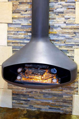 Hanging open fireplace in iron with chimney Stock Photo - 3396413