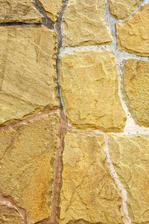 Wall made from natural rough yellow stones Stock Photo - 3396421