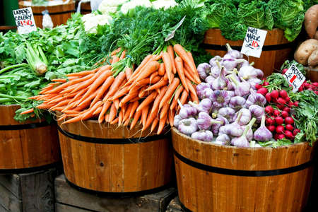 farmer's: Fresh organic vegetables in big wooden buckets Stock Photo