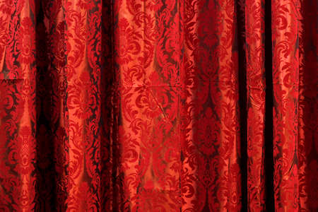 velvet: Wavy drapery material textile with red pattern