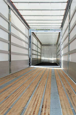 Interior view of empty semi truck trailer photo