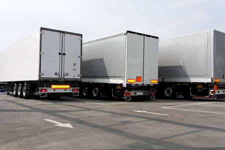 towed: Three big lorry trailers in grey color